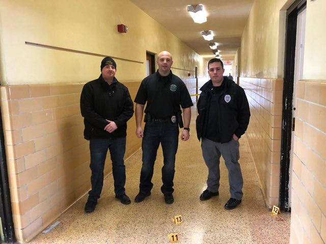 Officers in hallway